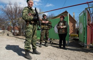 NAF soldiers talk to a resident in Shirokino