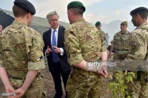 British Defence Secretary Michael Fallon with UK instructors after military exercises with Ukrainian forces near Ghytomyr, some 150 km west of Kiev. (--AFP/ Sergei Supinsky)