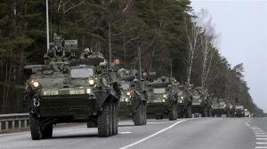 US Army 2nd Cavalry Regiment Arrives during Dragoon Ride exercise in Liepupe, Latvia, 22 March 2015.