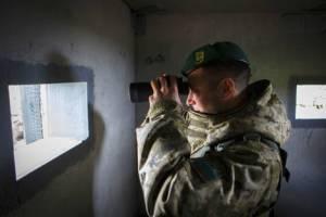 "Soldier at border checkpoint ""Goptovka"" on Ukrainian-Russian border, Dergachevsky area. (--Konstantin Cherginskiy/TASS)"